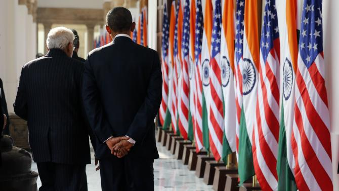 India's Prime Minister Modi and U.S. President Barack Obama talk as they walk through Hyderabad House in New Delhi