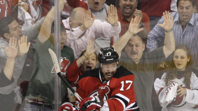 FILE - In this May 25, 2012, file photo, New Jersey Devils' Ilya Kovalchuk, of Russia, celebrates in front of fans after scoring a goal during Game 6 of the NHL hockey Stanley Cup Eastern Conference finals against the New York Rangers, in Newark, N.J. Kovalchuk is retiring from the NHL and returning to Russia. The Devils announced the stunning news Thursday afternoon, July 11, 2013, in a statement, saying that the 30-year-old Kovalchuk had alerted general manager and president Lou Lamoriello earlier this year that he wanted to return home with his family after 11 seasons in the NHL. (AP Photo/Frank Franklin II, File)