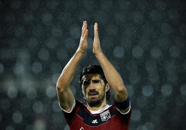 Olympique Lyonnais' Milan Bisevac, from Serbia, celebrates his team's 2-1 victory over Victoria Guimaraes after their Europa League Group I soccer match at the D. Afonso Henriques Stadium, in