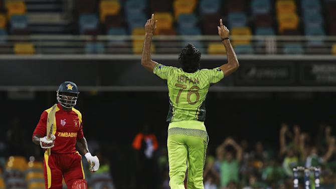Pakistan's Mohammad Irfan celebrates the wicket of Zimbabwe's Solomon Mire during their Pool B Cricket World Cup match in Brisbane, Australia, Sunday, March 1, 2015. (AP Photo/Tertius Pickard)