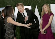 Sandra Bullock, Conan O'Brien and wife Liza Joke around before posing on the carpet at the 2013 Vanity Fair Oscars Party in West Hollywood, California February 24, 2013. REUTERS/Danny Moloshok