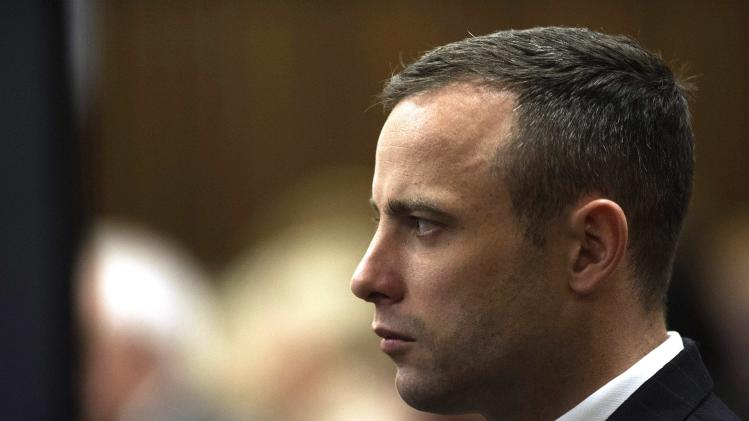 South African Olympic and Paralympic athlete Oscar Pistorius looks on during his murder trial in the North Gauteng High Court in Pretoria