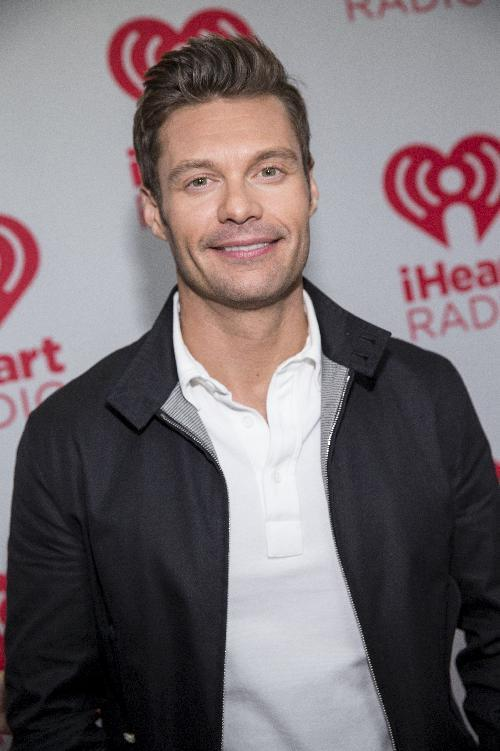 Ryan Seacrest arrives at the iHeartRadio Music Festival, Friday Sept. 20th, 2013, at the MGM Grand Garden Arena in Las Vegas. (Photo by Eric Jamison/Invision/AP Images)