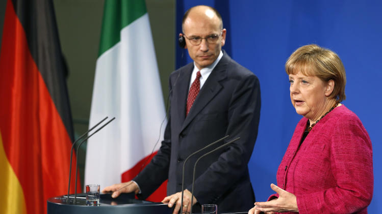 """German Chancellor Angela Merkel, right, and the Prime Minister of Italy, Enrico Letta, left, address the media during a press conference as part of a meeting at the chancellery in Berlin, Germany, Tuesday, April 30, 2013. Italy's prime minister is urging the European Union to drop its insistence on austerity policies and promote initiatives fostering growth instead. Prime Minister Enrico Letta said Tuesday in Germany """"it is absolutely necessary"""" to foster growth and job creation to help the 27-nation bloc's stalling economies """"so that our citizens see Europe not as something negative but as something positive.""""  (AP Photo/Michael Sohn)"""
