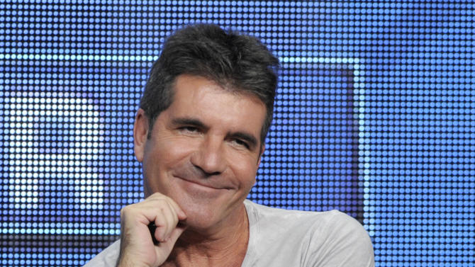 """FILE - This Aug. 1, 2013 file photo shows Simon Cowell, a judge on the """"The X Factor,"""" smiles from the stage during a panel discussion on the show at the FOX 2013 Summer TCA press tour in Beverly Hills, Calif. The British edition of """"The X Factor"""" is coming to U.S. television. Music entertainment cable channel AXS TV said Wednesday, Aug. 6, 2014, it will begin airing the singing contest's 11th season on Labor Day weekend. """"X Factor"""" creator Simon Cowell is on the judging panel, which includes ex-Spice Girl Mel B and pop singer Cheryl Fernandez-Versini, formerly known as Cheryl Cole. (Photo by Chris Pizzello/Invision/AP, File)"""