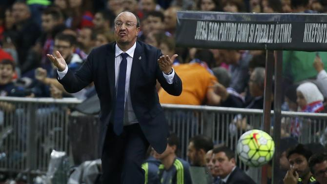 Real Madrid's coach Rafa Benitez gestures to players during their Spanish first division derby soccer match in Madrid