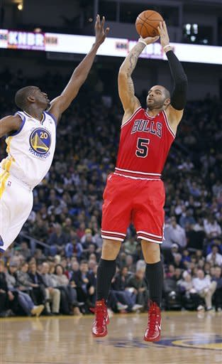 Curry leads Warriors to 99-91 win over Bulls