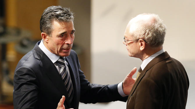 NATO secretary General Anders Fogh Rasmussen, left, and European Council President Herman Van Rompuy chat during the 50th Security Conference in Munich, Germany, Saturday, Feb. 1, 2014. A three-day security meeting continues. (AP Photo/Frank Augstein)