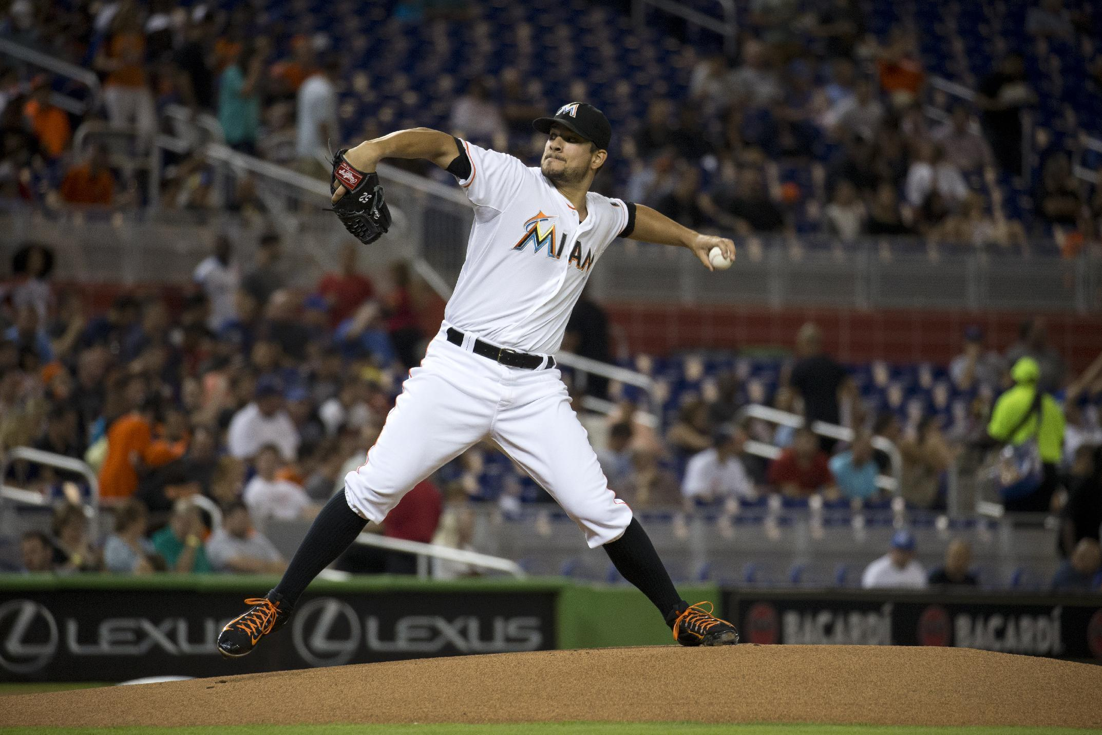 Brad Hand pitches Marlins past Cubs 5-2