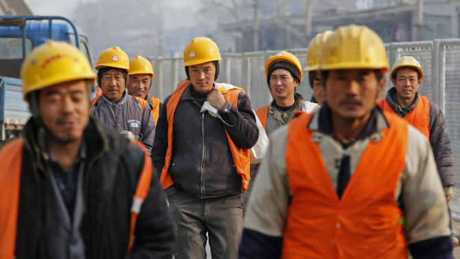 Workers head to a construction site in Beijing