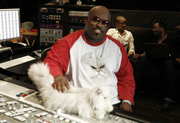 In this May 2, 2012 photo, musician Cee-Lo Green and Purrfect the cat pose for a photo while working on the remix of the Meow Mix jingle in Los Angeles. Green, a judge on the singing competition series &quot;The Voice,&quot; says he&#39;ll stick with the show &quot;as long as it&#39;s fresh.&quot; The rapper turned singer joined the show last year as coach and judge alongside Christina Aguilera, Blake Shelton and Adam Levine. (AP Photo/Matt Sayles)