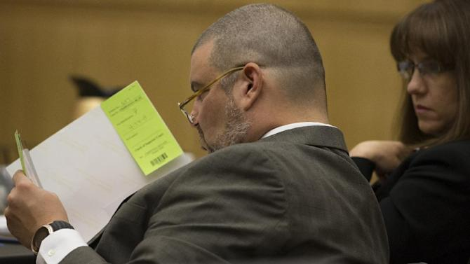 Defense attorney Kirk Nurmi, left, looks at photos during the Jodi Arias murder trial on Wednesday, April 24, 2013. Arias faces a potential death sentence if convicted of first-degree murder in the June 2008 killing of her one-time boyfriend at his suburban Phoenix home. Authorities say she planned the attack on Travis Alexander in a jealous rage. Looking on is defense attorney Jennifer Wilmott. (AP Photo/The Arizona Republic, Mark Henle, Pool)