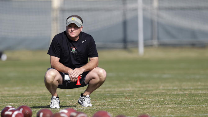 FILE 0- In this Dec. 30, 2011 file photo, Oregon head coach Chip Kellywatches  practice in Carson, Calif. The Philadelphia Eagles have hired Kelly after he originally chose to stay at Oregon. Kelly becomes the 21st coach in team history and replaces Andy Reid, who was fired on Dec. 31 after a 4-12 season.(AP Photo/Jae C. Hong, File)
