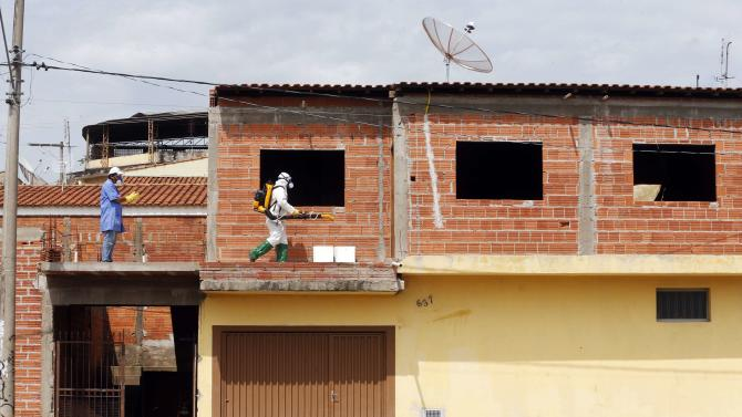 A national health official carries out fumigation in a house to help control the spread of Chikungunya and dengue fever, which are caused by viruses carried by mosquitoes, in Rio Claro