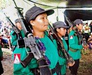 New People's Army (NPA) rebels on parade at an unspecified location in Surigao del Sur province, in the Philippine island of Mindanao. Philippine soldiers killed 13 communist guerrilla rebels in two separate clashes on Saturday, in what military officials described as one of the biggest victories over the insurgents in years