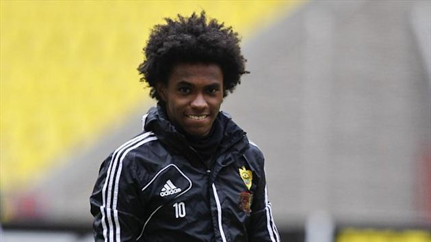 Anzhi Makhachkala's Willian smiles during a training session at the Luzhniki stadium in Moscow (Reuters)