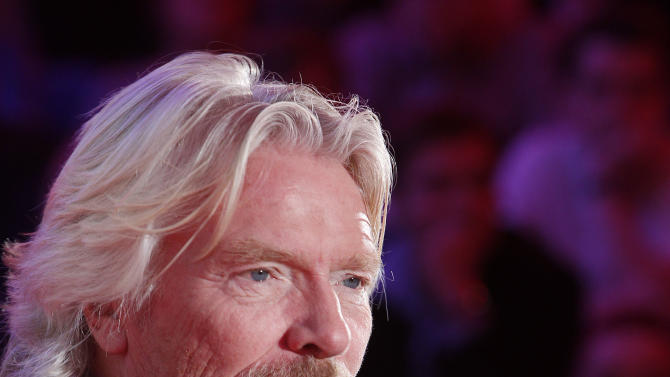 """Virgin Group owner, British billionaire Richard Branson tells students packing a hall at Warsaw University that they need to be """"passionate about whatever you are doing in life"""" to achieve success during a launch of Virgin Academy, a project to help young Poles start their businesses in Warsaw, Poland, on Wednesday, Oct. 24, 2012.  (AP Photo/Czarek Sokolowski)"""
