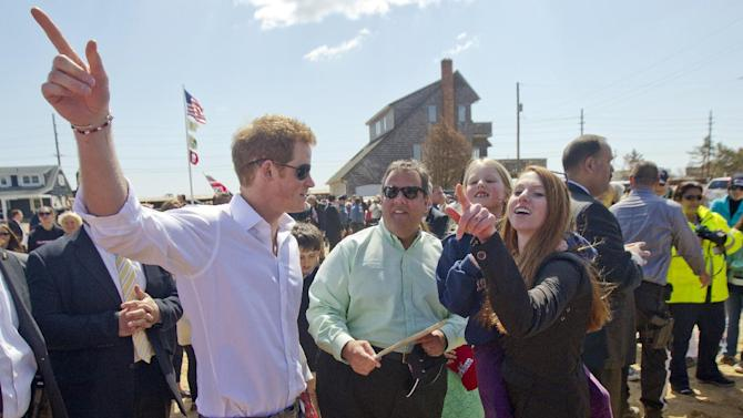 Britain's Prince Harry and N..J. Gov. Chris Christie talk with members of the the Bowden family on their empty lot in Mantoloking, N.J. on Tuesday, May 14, 2013.  Prince Harry began a tour Tuesday of New Jersey's storm-damaged coastline, inspecting dune construction, walking past destroyed homes and shaking hands with police and other emergency workers.  (AP Photo/The Star-Ledger, Andrew Mills, Pool)