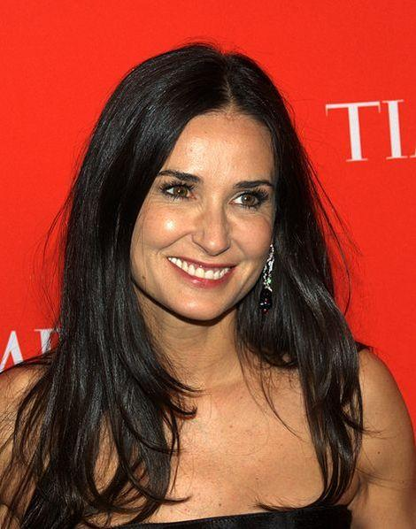 Demi Moore knows how to work a pose with or without a man!