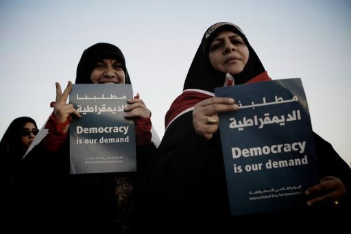"Bahraini Shiite Muslim women hold signs during an anti-government rally in the village of Shakhora, west of Manama, on September 14. Bahrain said Wednesday it accepted ""90 percent"" of reforms urged by the UN Human Rights Council (HRC) in the wake of a popular uprising, amid US criticism that the kingdom was dragging its feet"