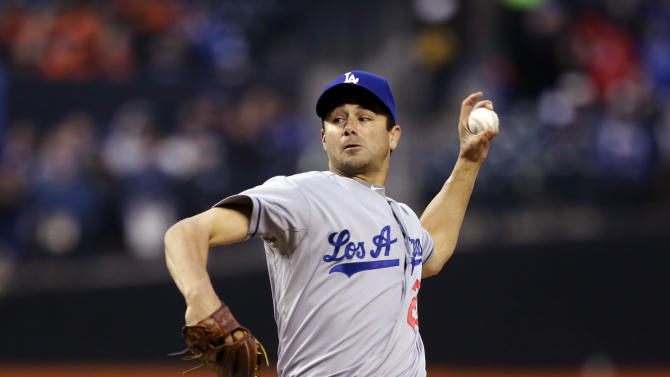 Los Angeles Dodgers starting pitcher Ted Lilly (29) winds up against the New York Mets in the first inning of a baseball game at Citi Field in New York, Wednesday, April 24, 2013. (AP Photo/Kathy Willens)