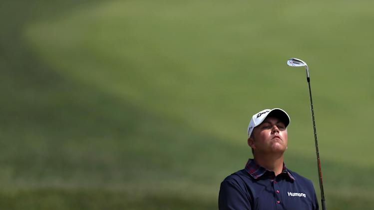 Bo Van Pelt peeks above the rim of a bunker to see where his shot ended up on the fourth green during the third round of the AT&T National golf tournament at Congressional Country Club in Bethesda, Md., Saturday, June 30, 2012. (AP Photo/Patrick Semansky)