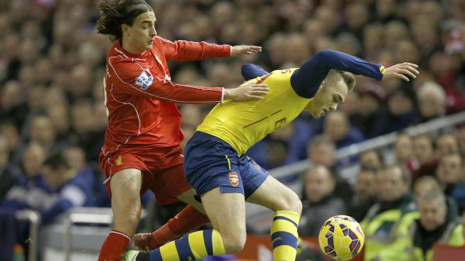 Liverpool's Lazar Markovic challenges Arsenal's Calum Chambers during their English Premier League soccer match at Anfield in Liverpool