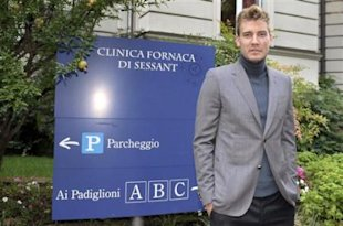 Denmark forward Nicklas Bendtner poses for photographers in Turin, Italy, Friday, Aug. 31, 2012. Denmark forward Nicklas Bendtner is finalizing a loa