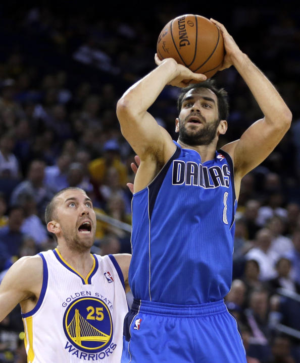 Dallas Mavericks' Jose Calderon, right, shoots over Golden State Warriors' Steve Blake (25) during the first half of an NBA basketball game, Tuesday, March 11, 2014, in Oakland, Calif