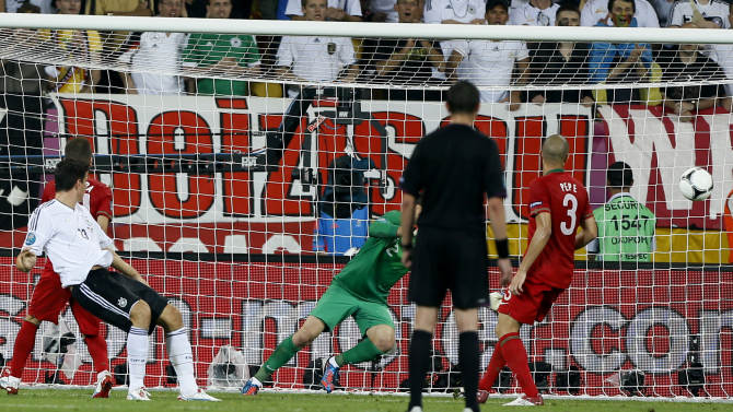 Germany's Mario Gomez, left front, scores during the Euro 2012 soccer championship Group B match between Germany and Portugal in Lviv, Ukraine, Saturday, June 9, 2012. (AP Photo/Frank Augstein)