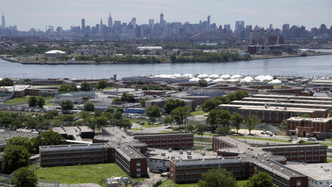This June 20, 2014 file photo shows the Rikers Island jail with the New York skyline in the background. Over the past five years, there have been three deaths in New York City's jails in which inmates were alleged to have been fatally beaten by guards. Yet in none of those cases was anyone ever charged with a crime. (AP Photo/Seth Wenig, File)