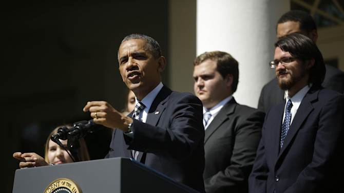 President Barack Obama, joined by college students, speaks in the Rose Garden of the White House in Washington, Friday, May 31, 2013, where he called on Congress to keep federally subsidized student loans rates from doubling on July 1. (AP Photo/Pablo Martinez Monsivais)