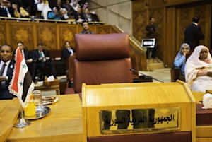 The empty chair of the Syrian representative is displayed …