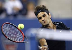 Federer of Switzerland comes to the net during his men's singles match against Matosevic of Australia at the U.S. Open tennis tournament in New York