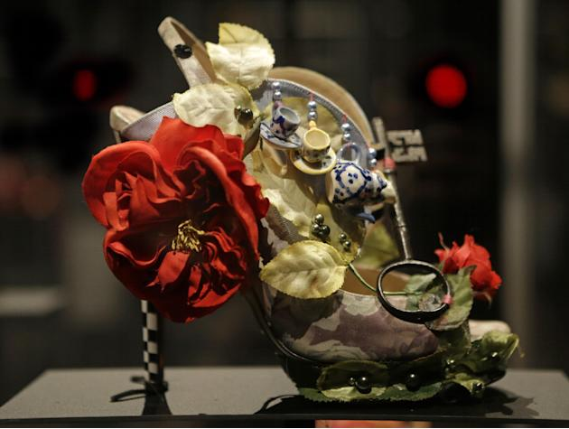 "This Feb. 11, 2013 photo shows a shoe decorated with a miniature tea set and a lock titled ""Alice,"" and designed by Nicholas Kirkwood, on display at the ""Shoe Obsession"" exhibit at The Museum at the F"