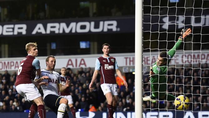 Tottenham Hotspur's Kane heads the ball to score past Burnley's goalkeeper Heaton during their English Premier League soccer match in London