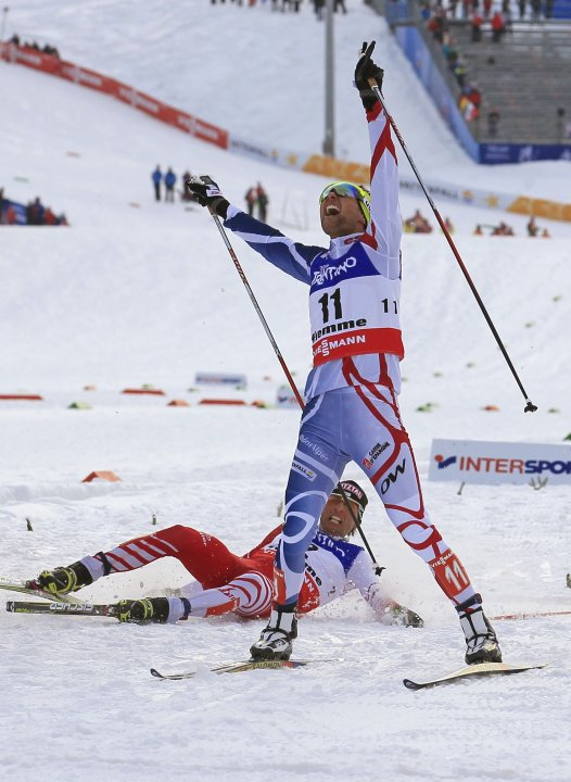 Chappuis of France crosses finish line to win in men's nordic combined individual Gundersen 10km competition at Nordic World Ski Championships in Val di Fiemme