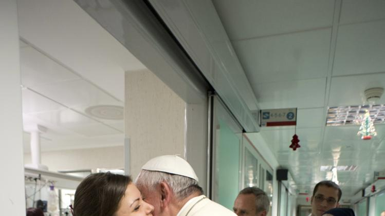 Pope Francis greets a female nurse during a visit at the Bambino Gesu Pediatric Hospital in Rom