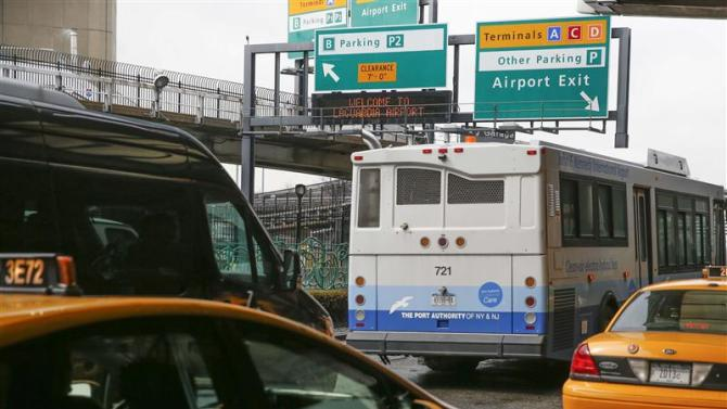 Crowded roadways are seen outside the central terminal of LaGuardia Airport in the Queens borough of New York