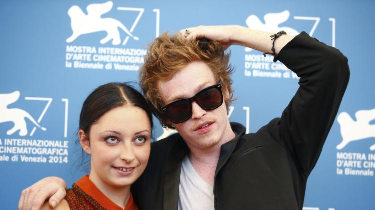 "Actress Arielle Holmes and actor Caleb Landry Jones pose during the photo call for the movie ""Heaven Knows What"" at the 71st Venice Film Festival"