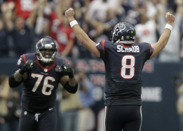 Houston Texans quarterback Matt Schaub (8) and Duane Brown (76) celebrate after beating the Jacksonville Jaguars 43-37 in overtime of an NFL football game Sunday, Nov. 18, 2012, in Houston. (AP Photo/