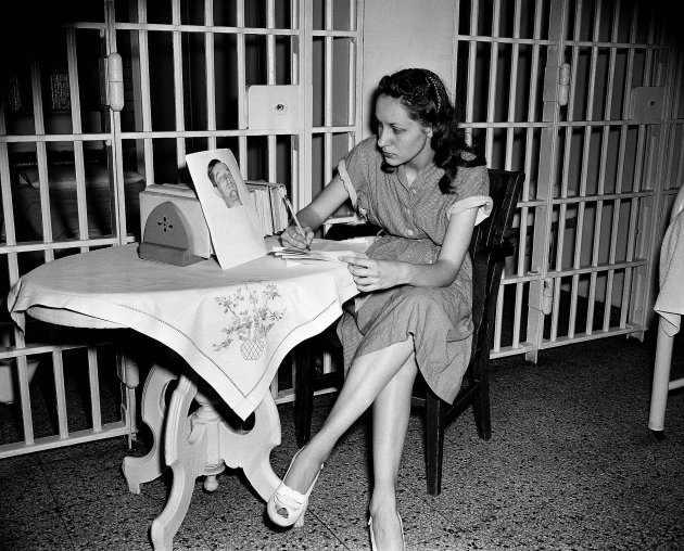 FILE - In this June 18, 1949 file photo, Ruth Steinhagen, 19, held in the shooting of Philadelphia Phillies first baseman Eddie Waitkus at a Chicago hotel on June 14, 1949, writes notes for her life h