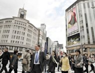 This file photo shows pedestrians crossing a street in Ginza district of Tokyo. The Bank of Japan will this week forecast that prices are set to rise less than one percent next fiscal year, according to a report, boosting the chances of fresh easing measures to stimulate the economy