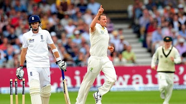 Peter Siddle, right, celebrates after bowling England's Joe Root