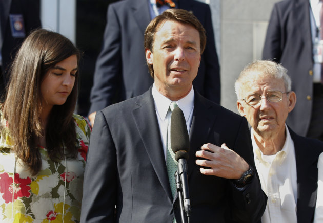 FILE - In a Thursday, May 31, 2012 file photo, former presidential candidate John Edwards speaks outside a federal courthouse as his daughter, Cate Edwards, left, and father Wallace Edwards, listen after his campaign finance fraud case ended in a mistrial, in Greensboro, N.C. Federal prosecutors on Wednesday, June 13, 2012 dropped all charges against Edwards after his corruption trial ended last month in a deadlocked jury. (AP Photo/Chuck Burton, File)