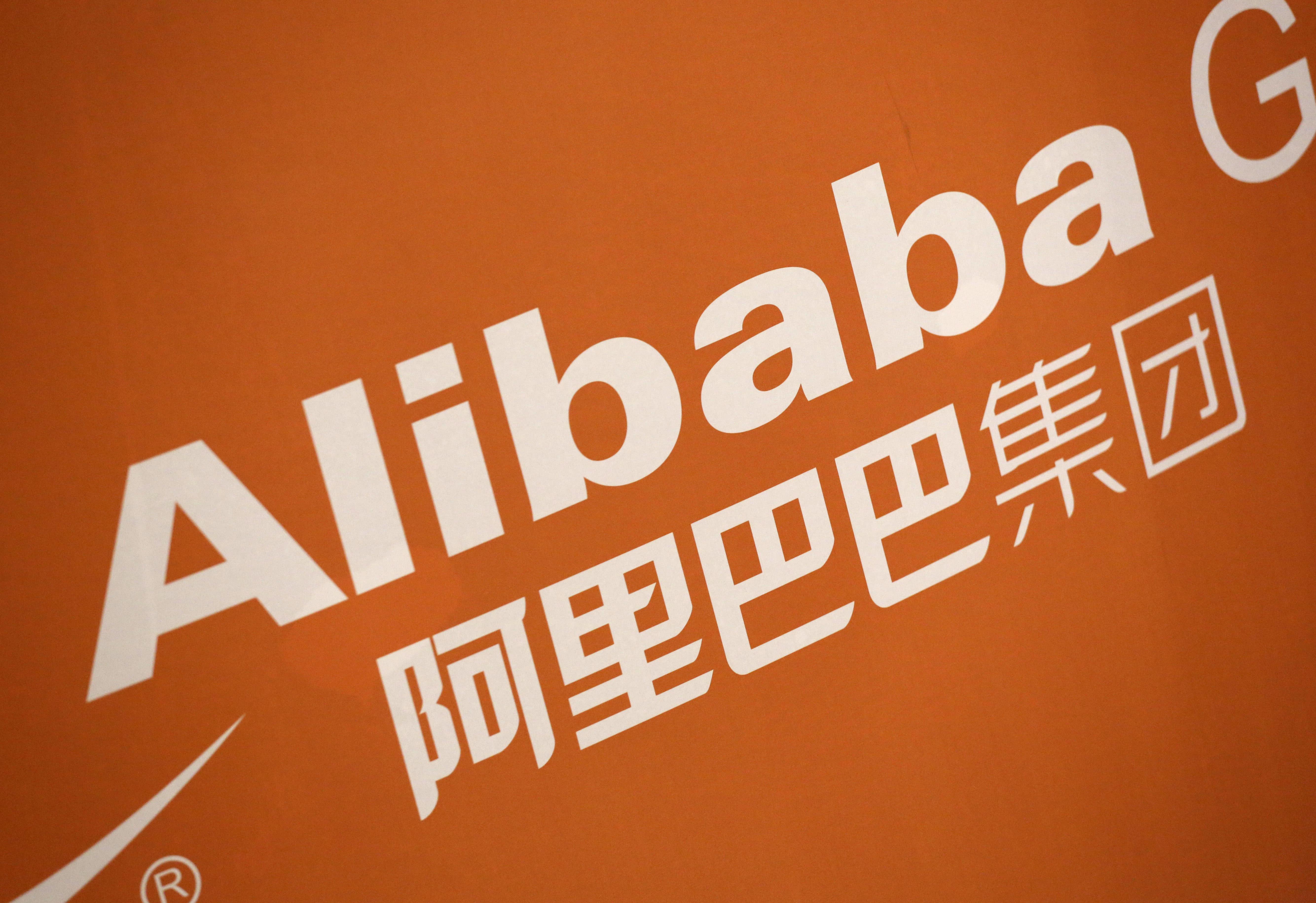 Alibaba adjusted profit tops estimates, revenue disappoints