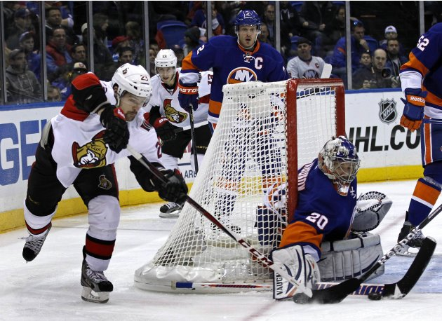 New York Islanders goalie Nabokov makes a save against Ottawa Senators left wing Daugavins in second period of their NHL hockey game in Uniondale