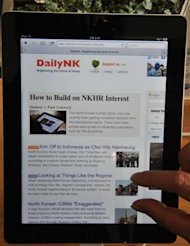 A man looks at the webpage of Daily NK on an iPad. The North's regime once exercised an iron grip on information sources, pre-tuning radios and televisions to official stations only and banning cellphones for years