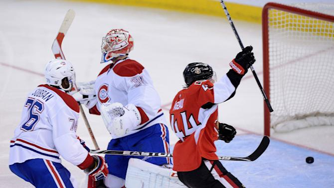 Ottawa Senators' Jean-Gabriel Pageau, right, celebrates a goal on Montreal Canadiens' Carey Price as P.K. Suban skates behind at right during the second period of game three of first round NHL Stanley Cup playoff hockey at the Scotiabank Place in Ottawa on Sunday, May 5, 2013. (AP Photo/The Canadian Press, Sean Kilpatrick)