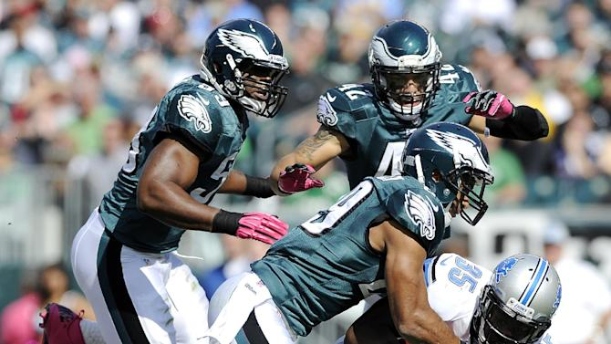 Detroit Lions running back Joique Bell (35) is tackled by Philadelphia Eagles players during the first half an NFL football game, Sunday, Oct. 14, 2012, in Philadelphia, Philadelphia. (AP Photo/Michael Perez)
